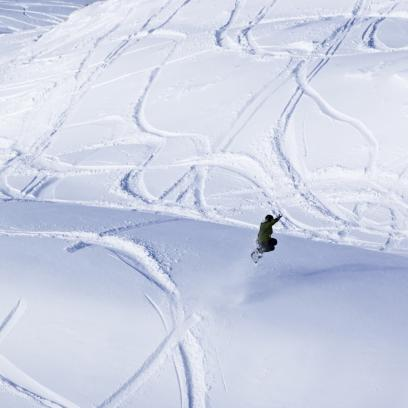 Catching air over fresh powdery snow at Coronet Peak media2