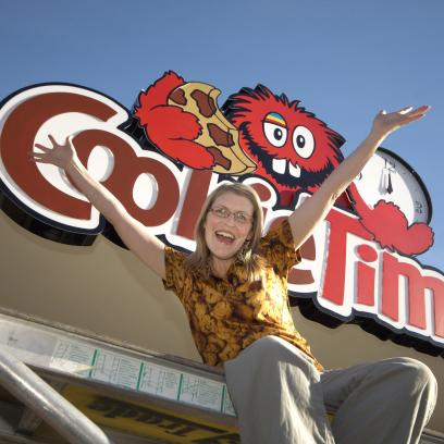 Cookie Time Queenstown franchisee Verity Richard with new sign